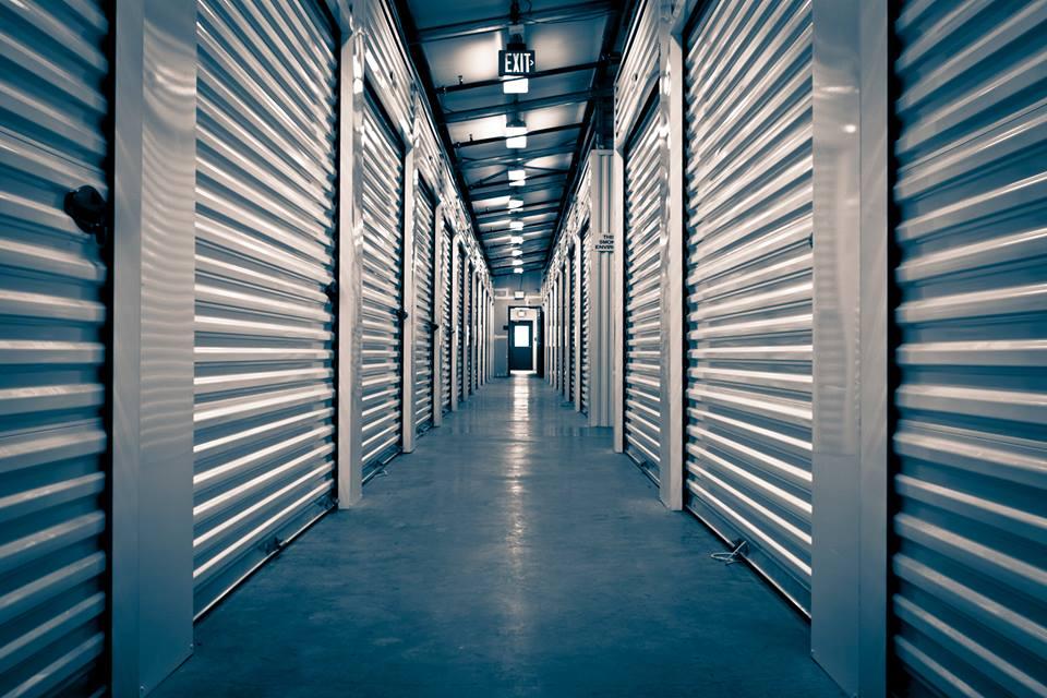 View of the hallway between storage units.